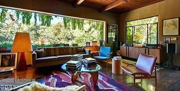 Rich Decor A Living Room Is Outfitted In 1970s Accents Including Mahogany Furniture And
