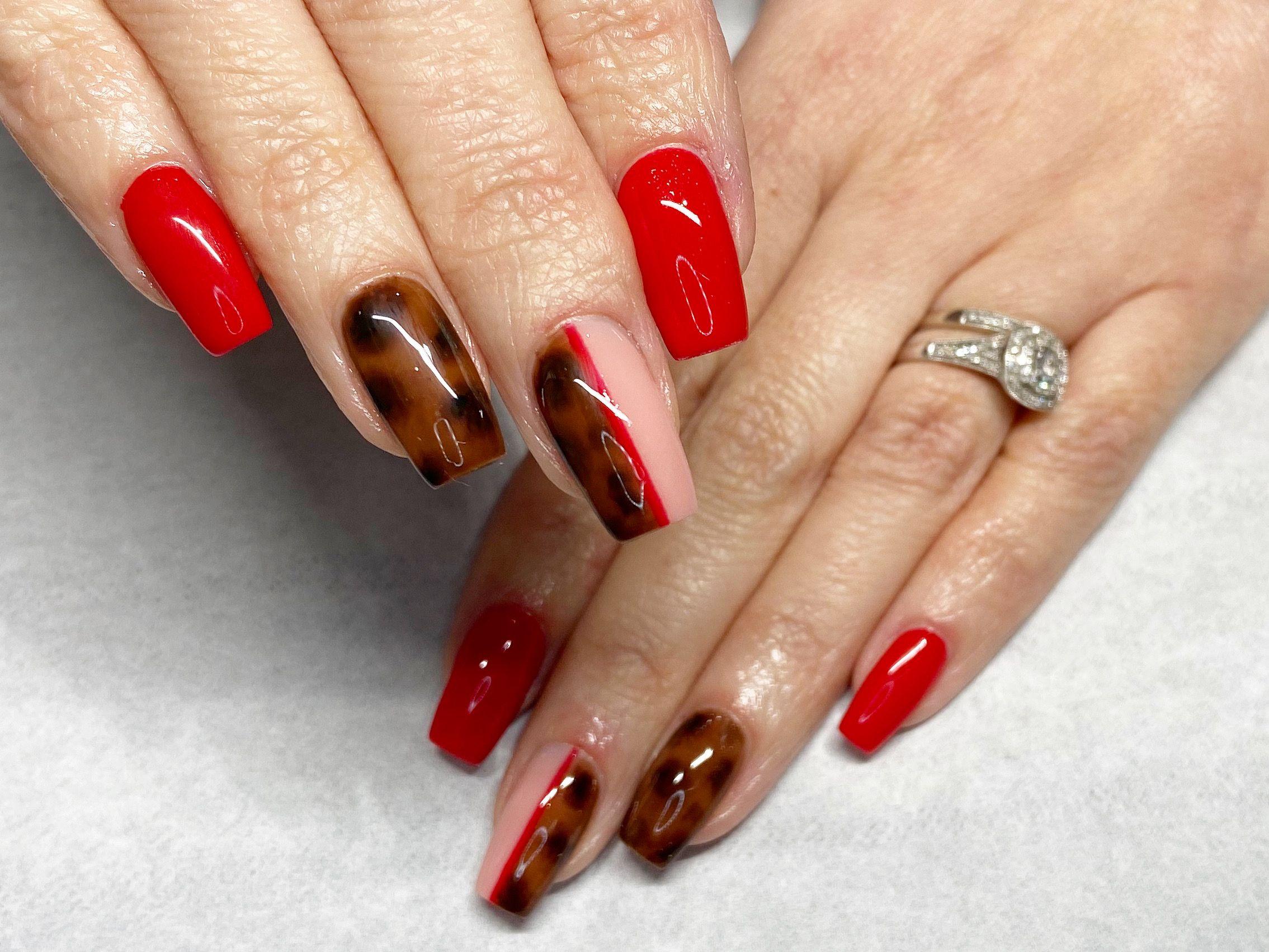 Red nails with tortoise shell design  #nails #thegelbottle #biab #nailtech #nailsbybeff #Staffordshire #biddulph #cheshire #nailart #love #fashion #nailtechnician #scratchmagazine  #nailaddict #nailpro #showscratch #polish #nailfie #nailartist