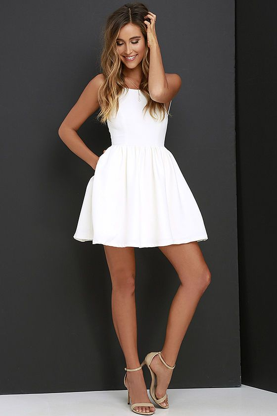 49acbaafe0 Profess your love for fashion with one key piece  the Chic Freely Ivory  Backless Skater Dress! Sightly stretchy woven fabric falls from slender…