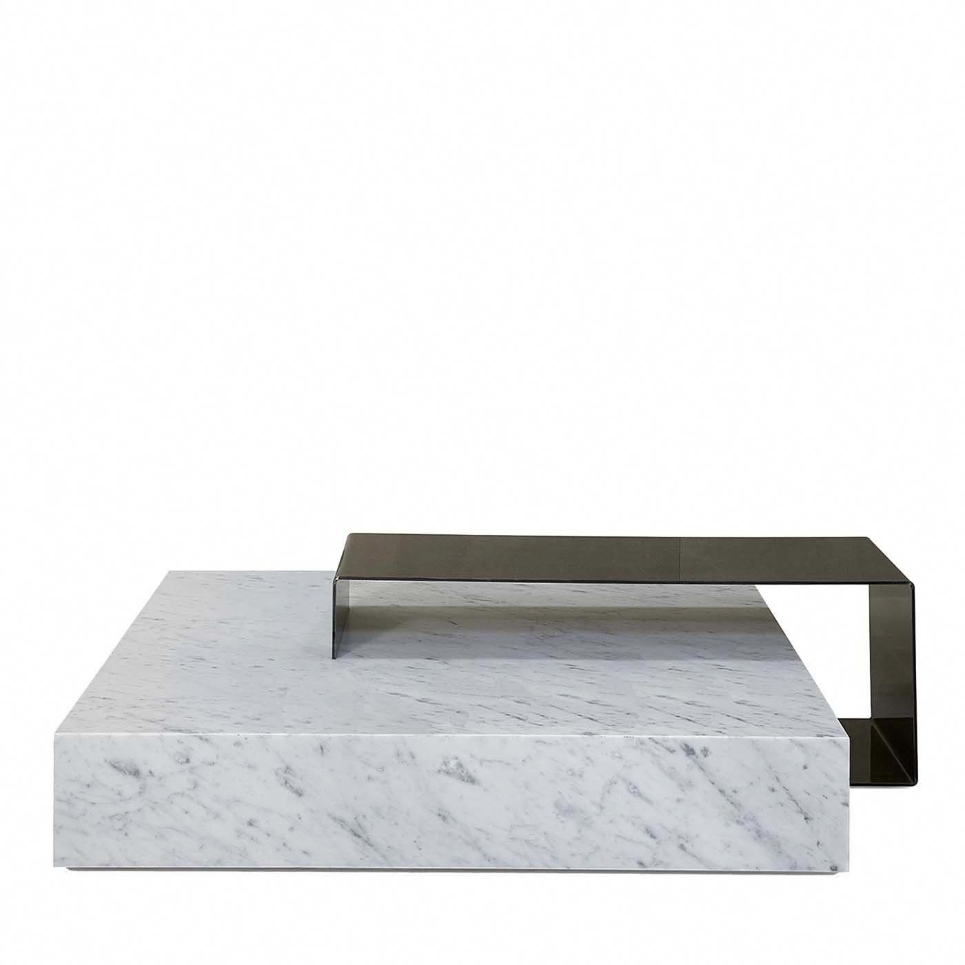 Ta Volo Coffee Table is part of Sectional Living Room Coffee Table - Designed by Franz Siccardi, this abstract sculptural work of art will infuse any decor with spellbinding sophistication  A solid square base fashioned out of white Carrara marble merges with an open iron frame, their geometric harmony and material contrast creating breathtaking lightness and textural depth  Daring and radical, Ta Volo®, a deft portmanteau, bridges the Italian words  volo  (flying) and  tavolo  (table), epitomizing the dynamic interplay of power of nature (through stone) and man (through iron) present in this work