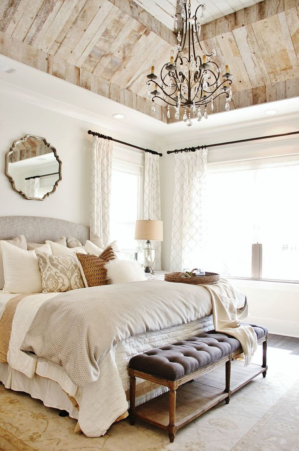 Chic Bedroom With Neutral Wall Color And Chandelier Over King Size ...