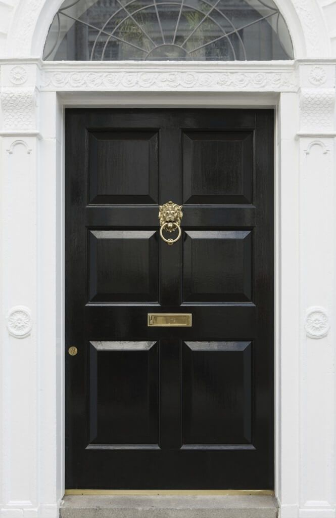 This Stately Black Door Features Deep Panels And Br Details Including Lock Cylinder Mail Slot Lion Head Knocker