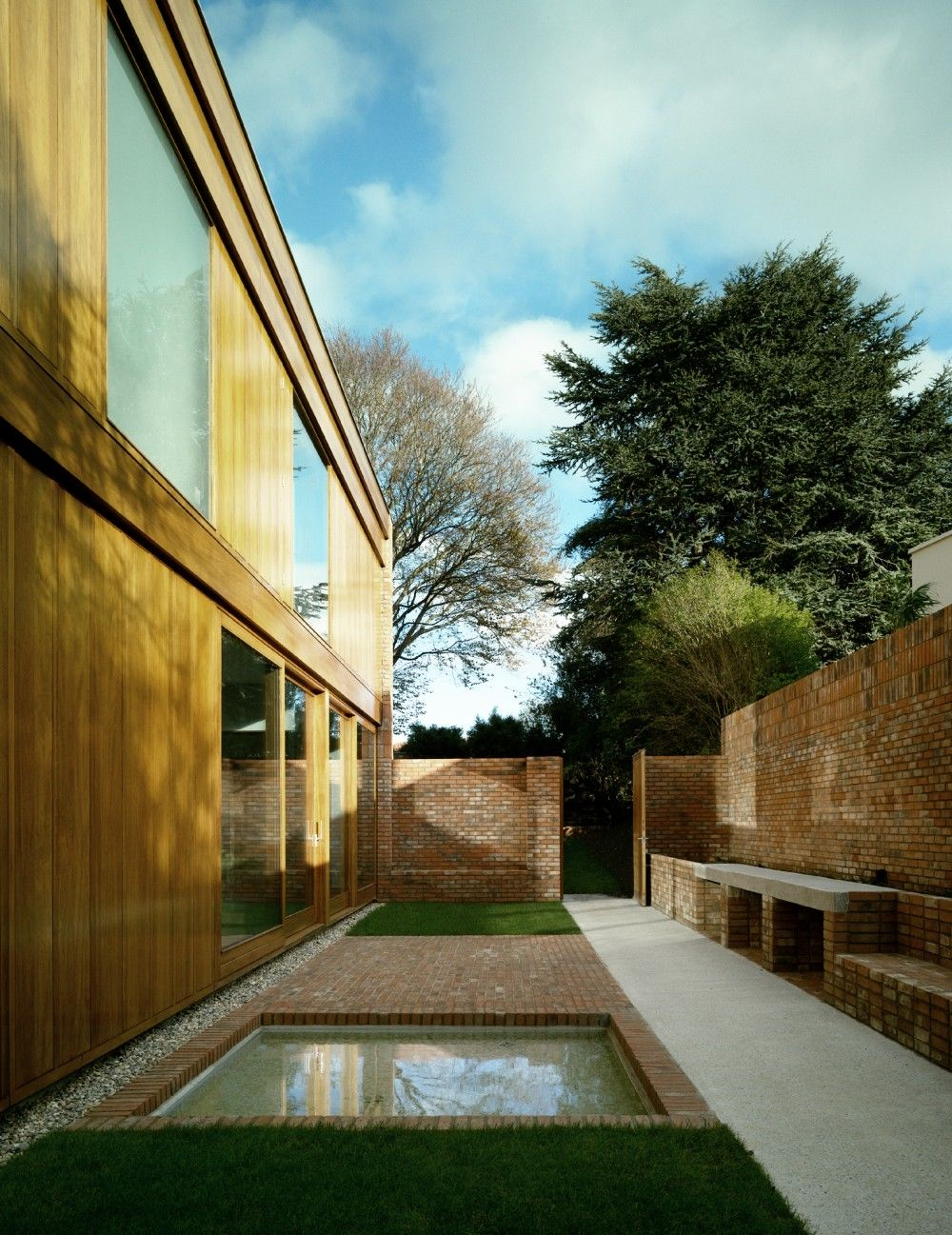 Brick House Addition In Dublin: Renewed Home In Dublin Boasting Wooden Details And A Brick Fence