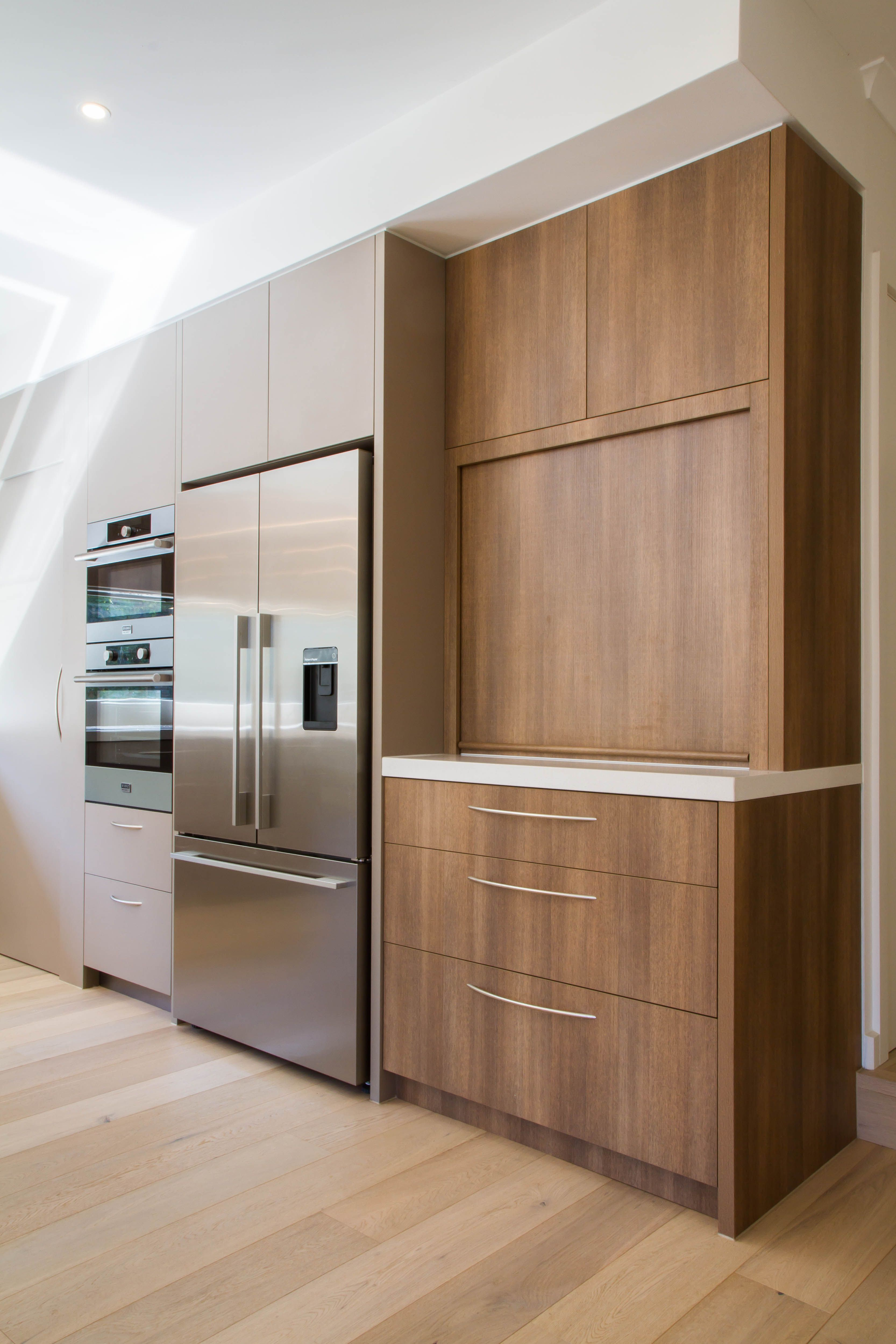 Large modern contemporary kitchen in warm tones