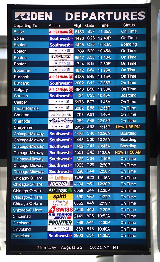 A departure board at Denver International Airport in