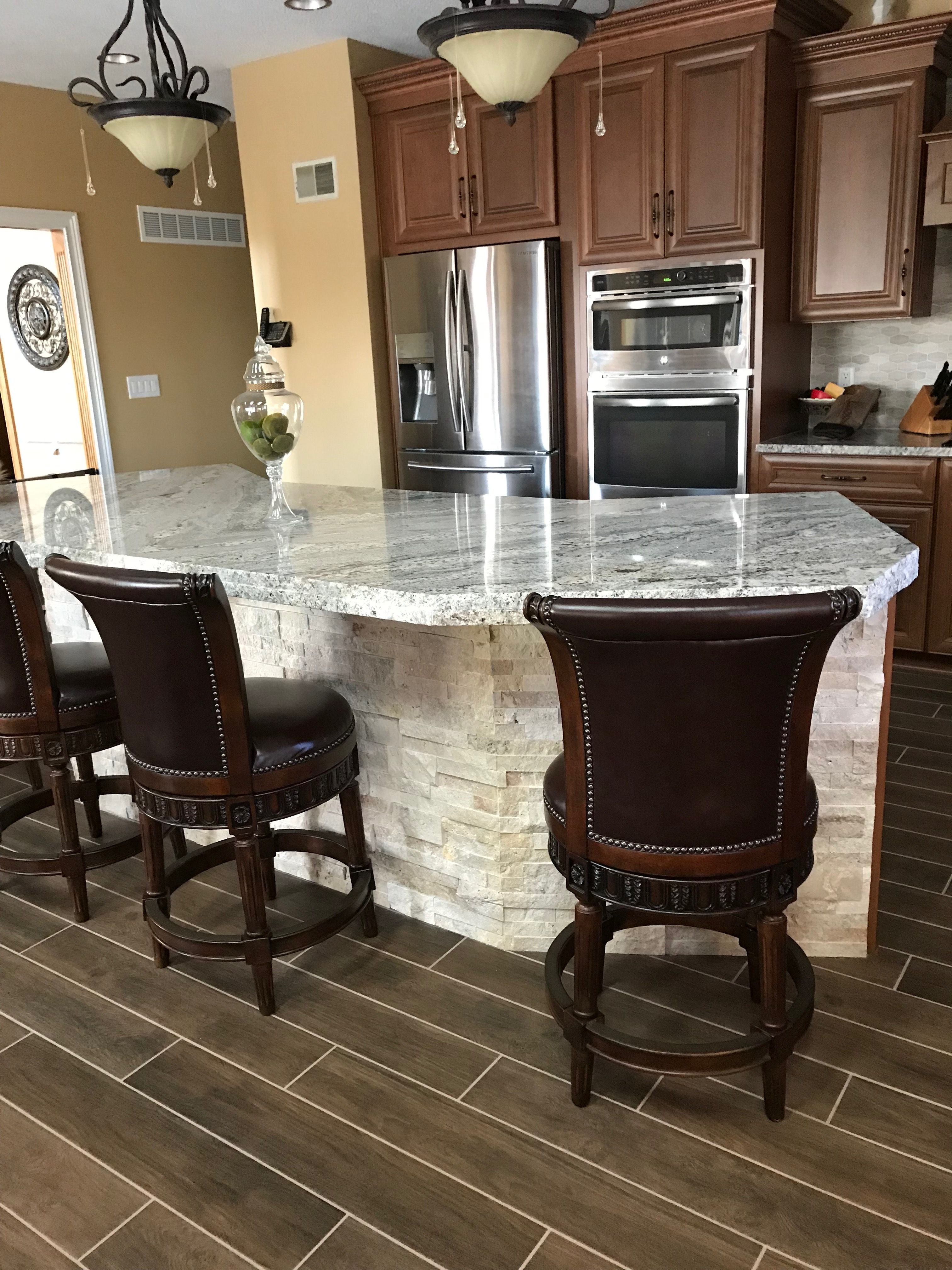 Stacked Stone On Front Of Kitchen Island Is Very Durable By The Stools Goes Well Wi Kitchen Island Decor Stone Kitchen Island Kitchen Island With Granite Top