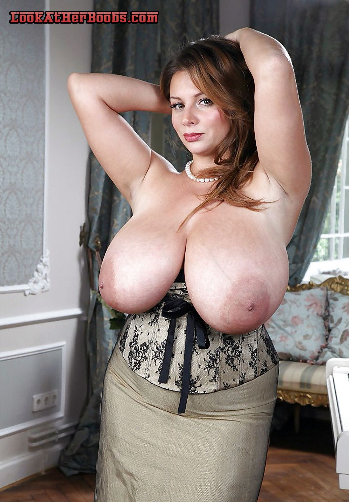 busty pinup girl flashing humongous titties. sexy redheaded bbw