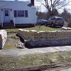 Our Inexpensive Retaining Wall Solutions We Used 80 Lb Concrete Bags Concrete Retaining Walls Cheap Retaining Wall Retaining Wall Cost