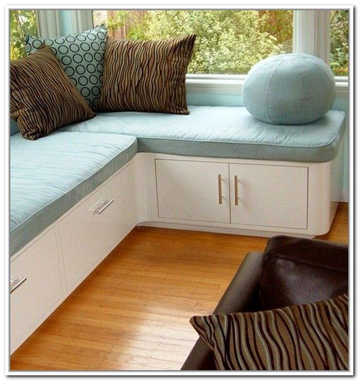 Modern Family Room With Corner Storage Bench Seat, Round Ball Blue Pillows  Design, And