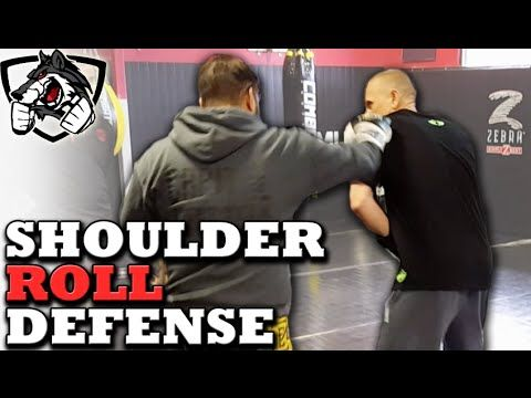 How To Shoulder Roll In Boxing Philly Shell Like Floyd Mayweather Martial Arts Workout Boxing Techniques Boxing Training Workout
