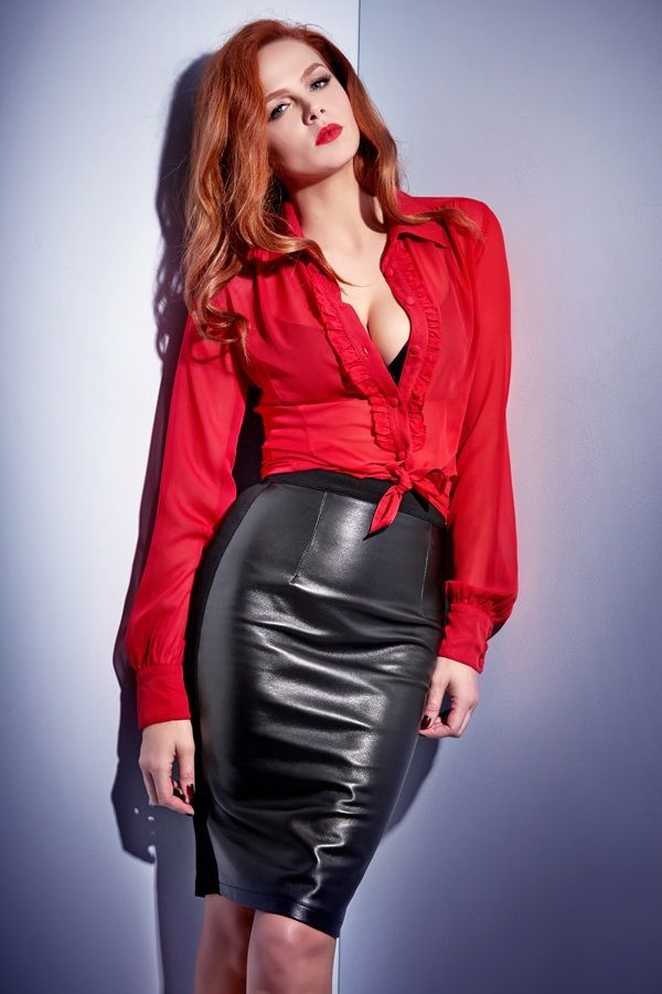 Sexy redhead in leather