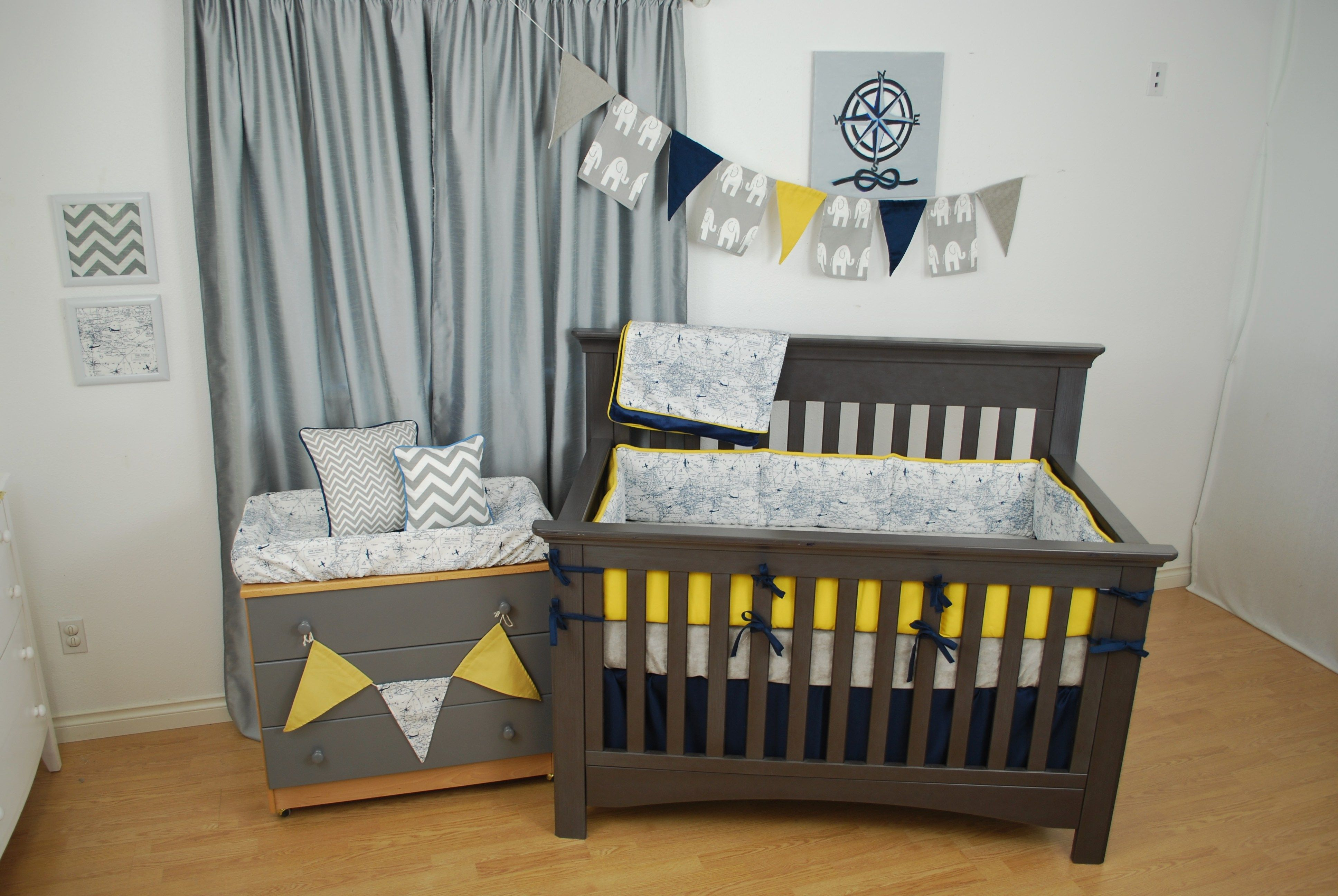 Navy World Map Crib Bedding With Bright Yellow And Grey In The Nursery