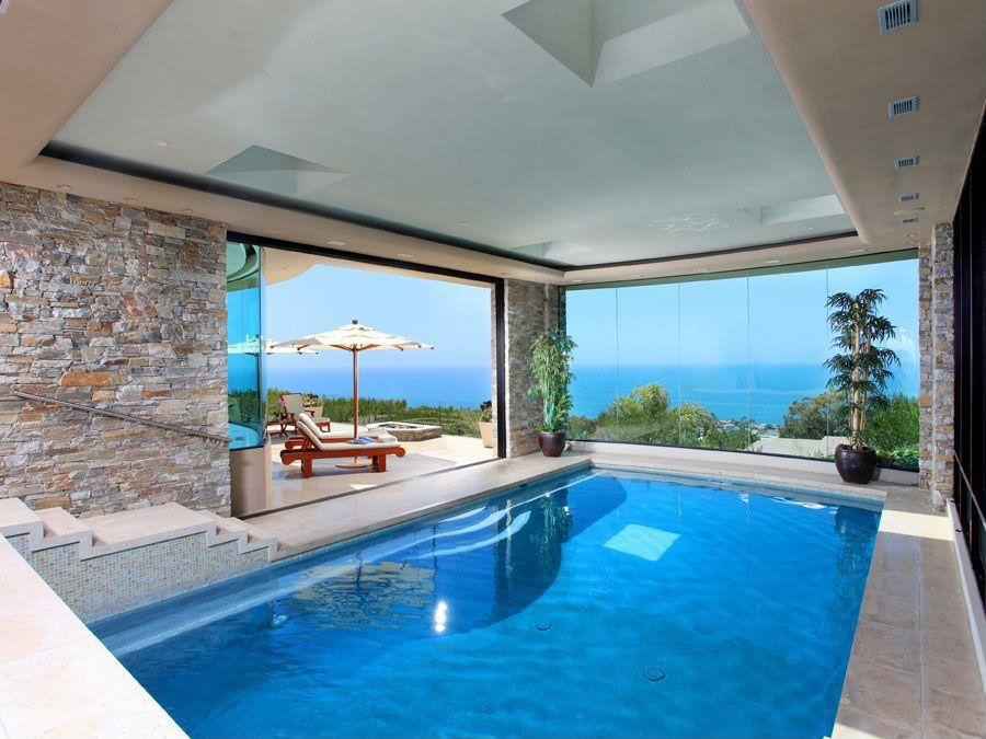 Modern indoor pool with ocean view saved from http www for Interior swimming pool