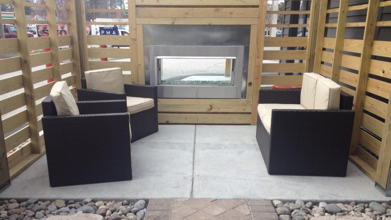Smoke BBQ Restaurant on Warwick Boulevard in Newport News gets an upgrade and new patio. This lounge area has a gas fireplace.