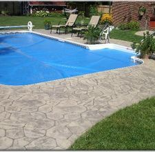 How To Resurface A Concrete Pool Deck Hunker Concrete Pool Concrete Patio Resurfacing Backyard Pool