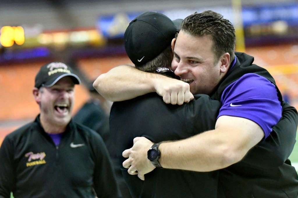 Troy Head Coach Bob Burns Right Celebrates With His Coaching