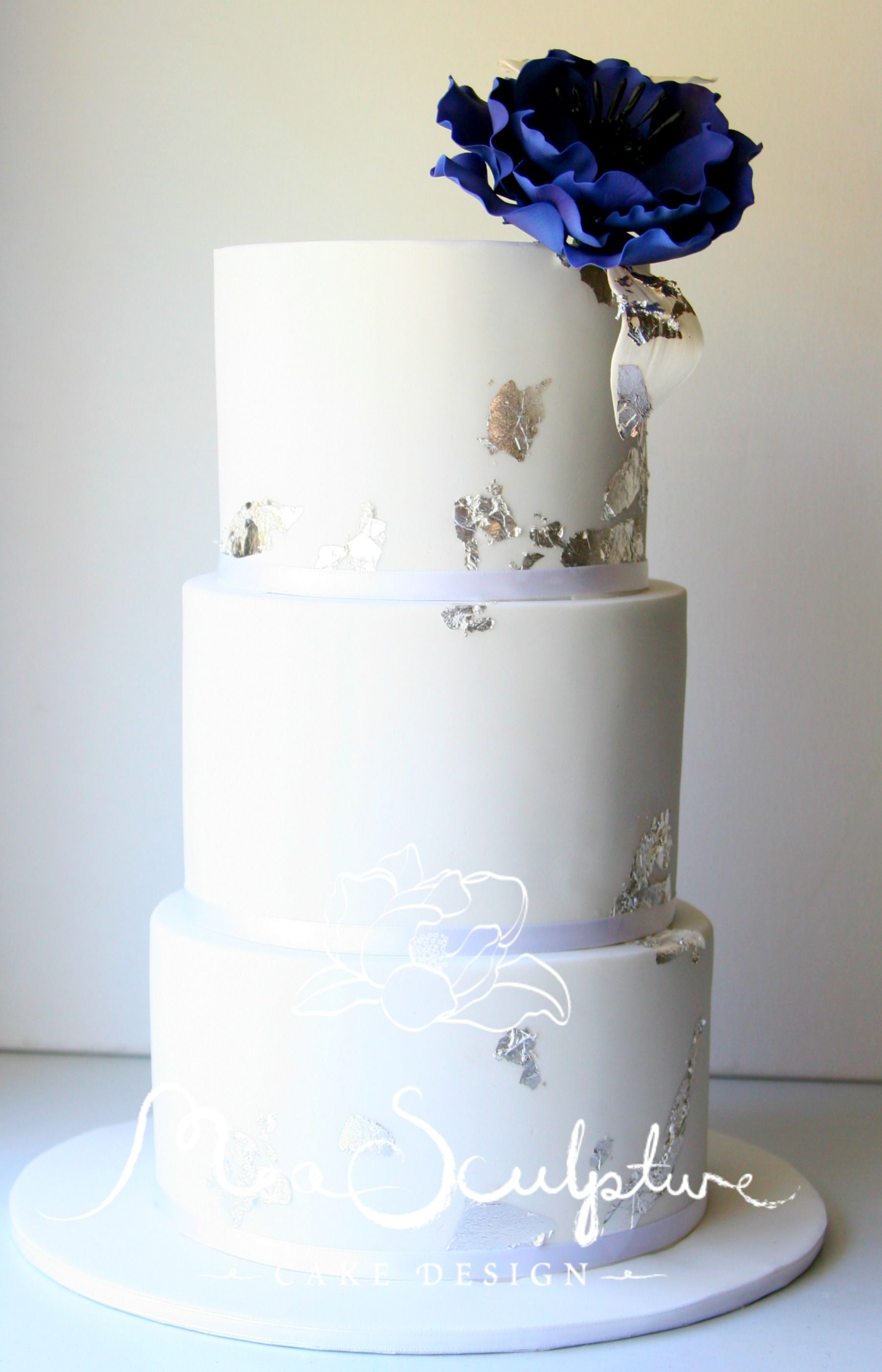 Eggplant purple open rose silver leaf and white three tier wedding ...