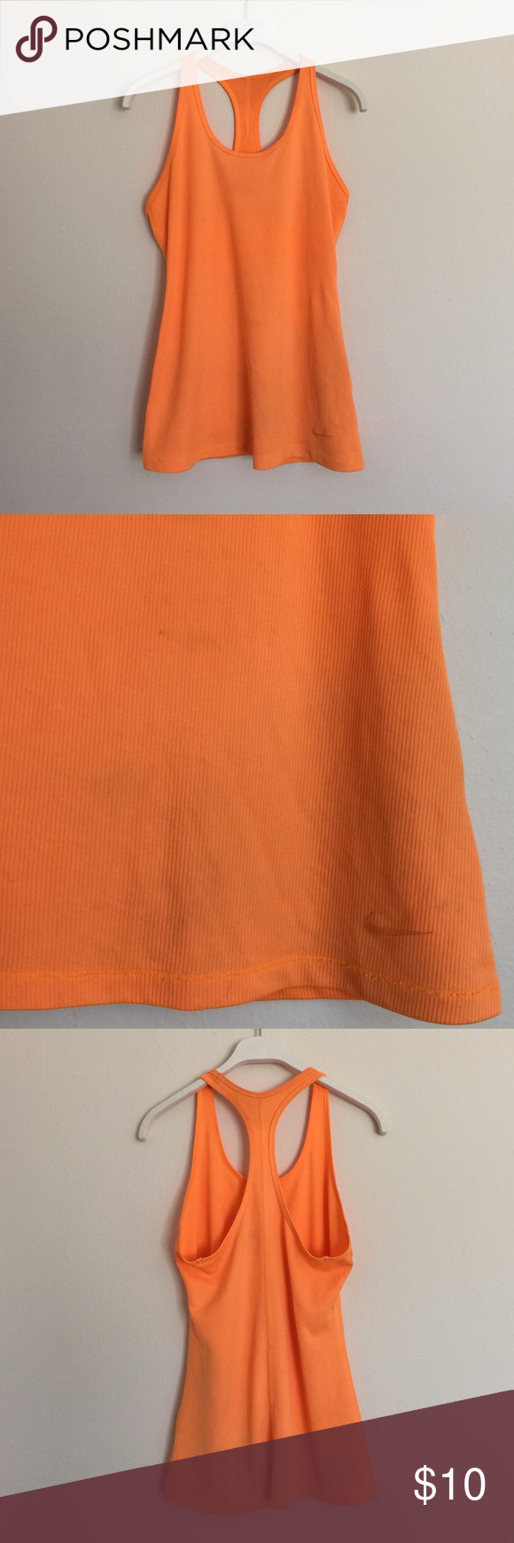 Nike Orange dri-fit racerback tank medium Love the bright color! Good condition but there is a faint discoloration pictured and a small snag in the fabric. Price reflected. Bundle to save 25%! Nike Tops Tank Tops