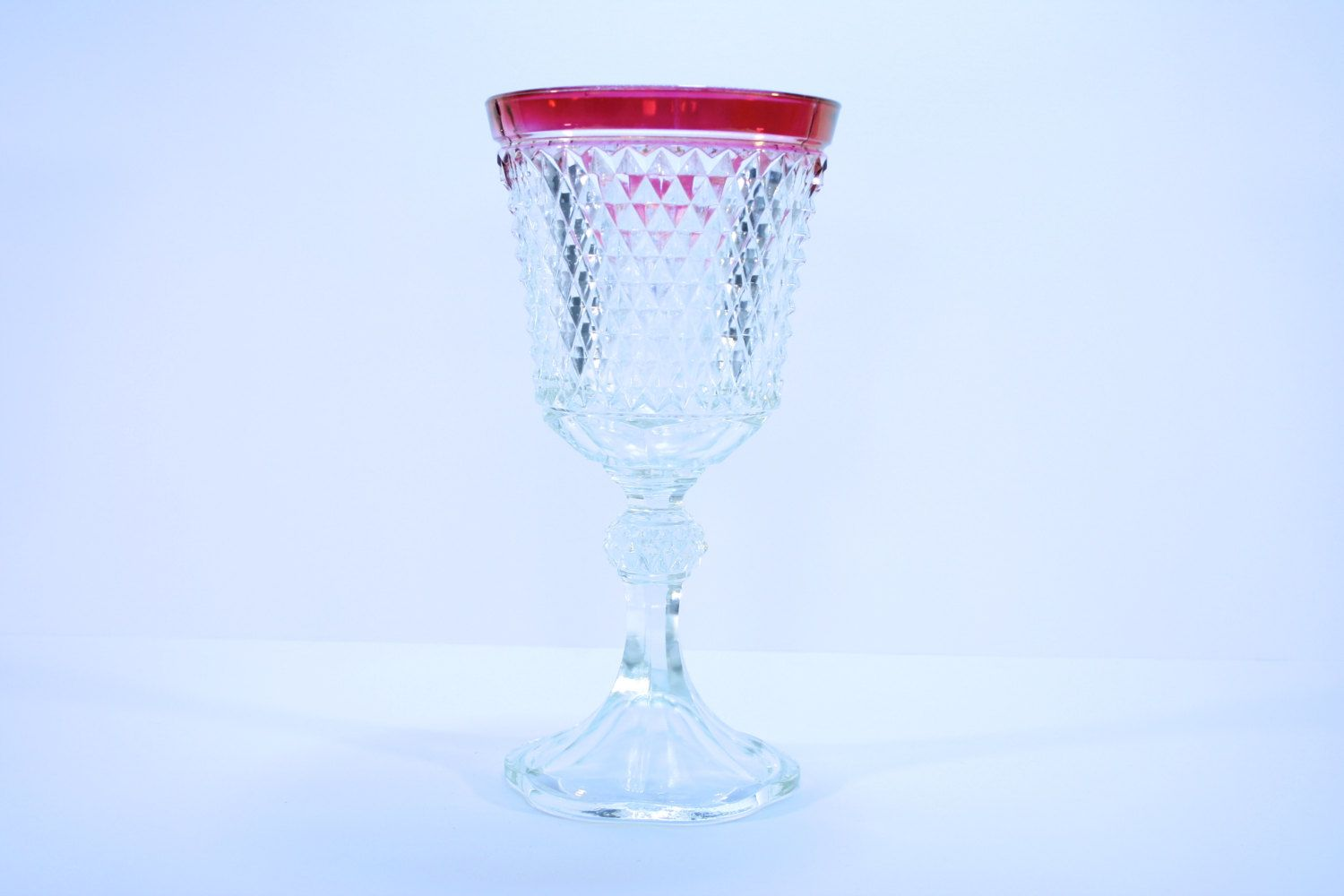 Vintage footed urn in diamond point ruby by indiana glass