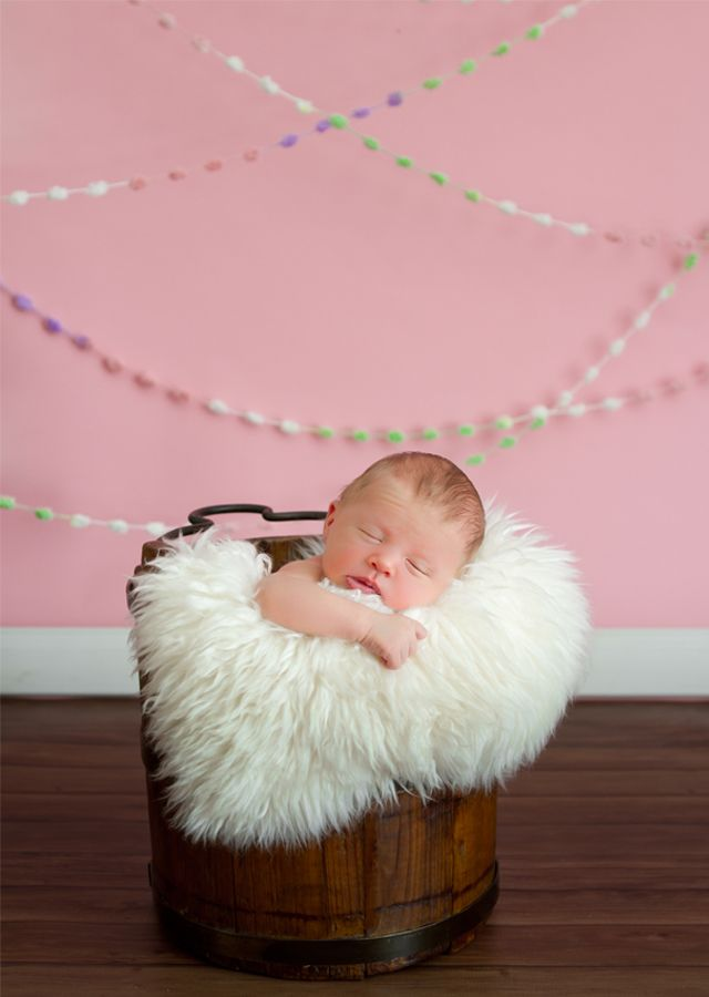 Simple and inexpensive photography props like this baby snowball yarn a string of pom poms from michaels by helen john photography and ideas for it