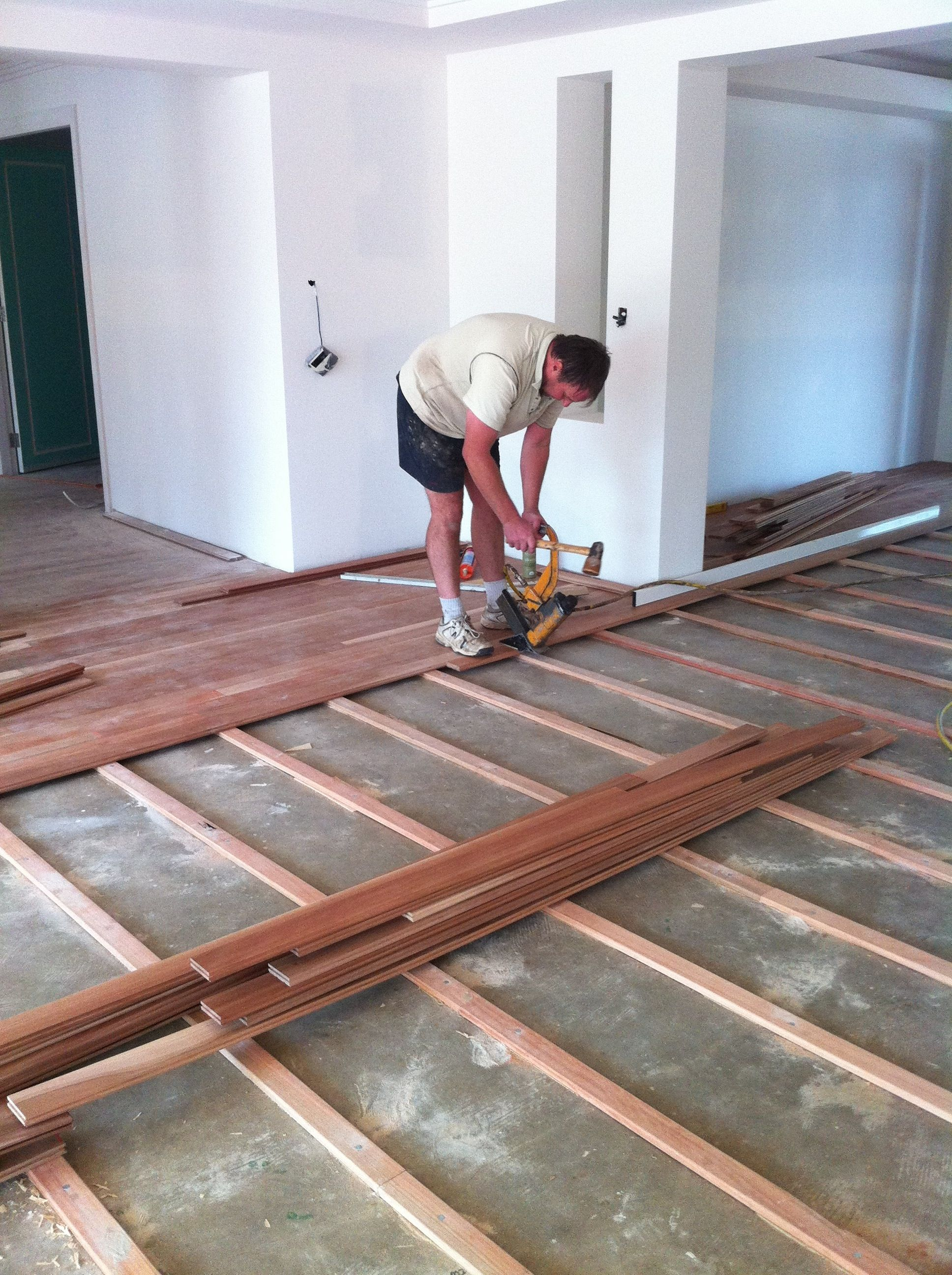 Laying Floating Solid Wood Flooring On Concrete Together With