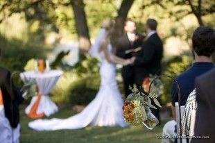 romantic outdoor wedding ceremony idea-- mason jars hanging from shepherds hooks filled with your wedding flowers