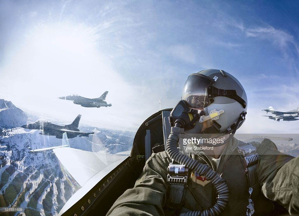 F-16 fighter pilot is flying above the Rocky Mountains in Colorado.