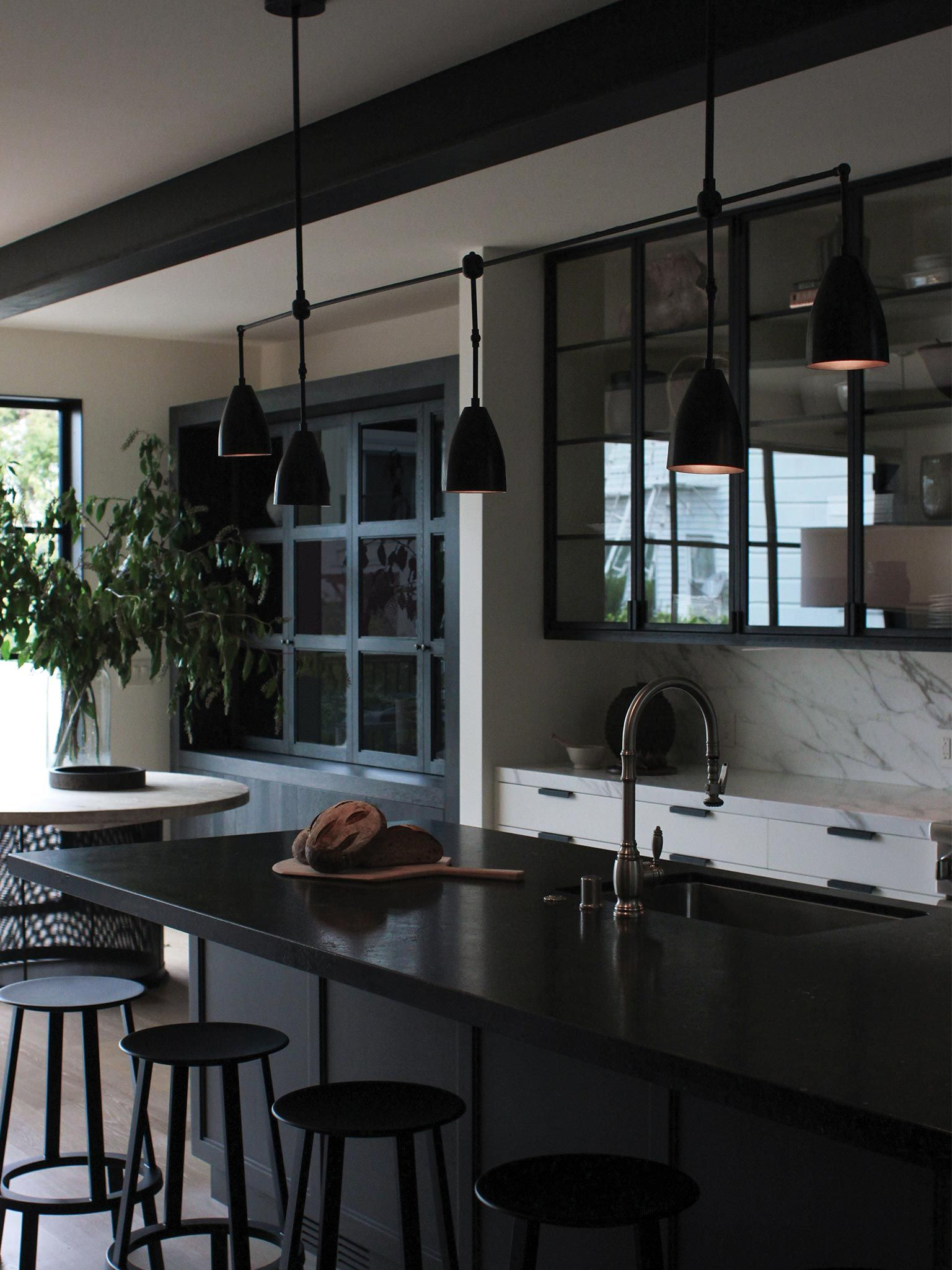 Black Metal And Glass Upper Cabinets Paired With White Base Drawers File Cabinet Style Pulls Marb Interior Design Kitchen Timeless Kitchen Kitchen Interior