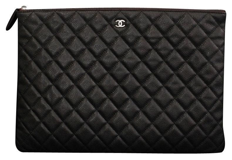 50a65af8baf0 Chanel Quilted Envelope Clutch  ipad Case. Free shipping and guaranteed  authenticity on Chanel Quilted