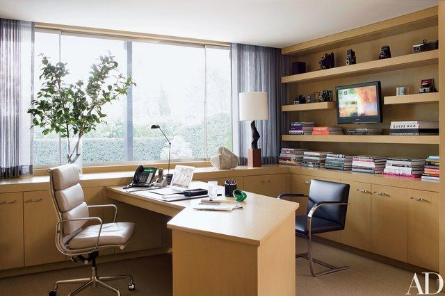 The office's Eames-designed swivel chair is by Herman Miller, and the Brno armchair is by Knoll.