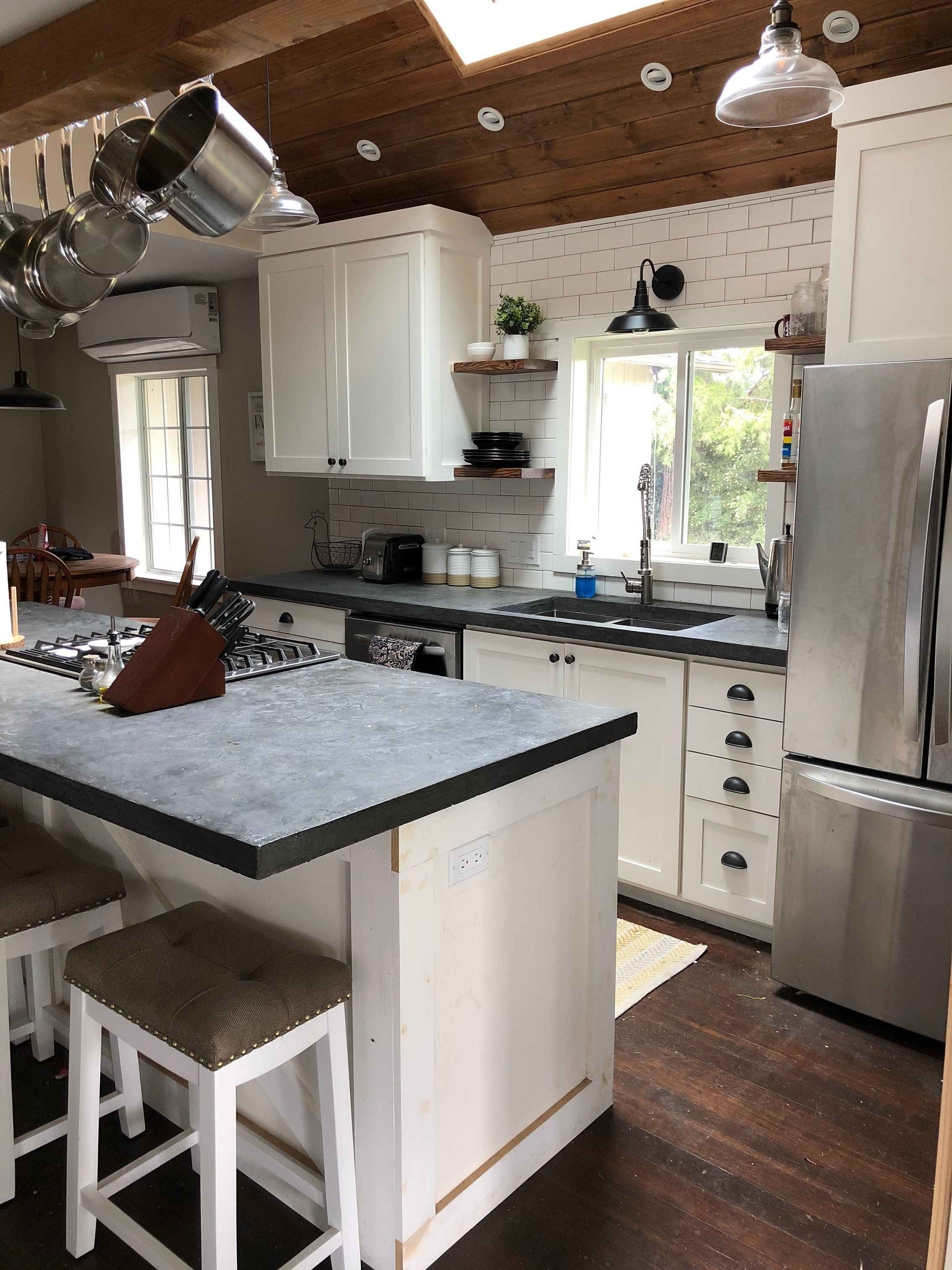 DIY farmhouse kitchen with concrete countertops and