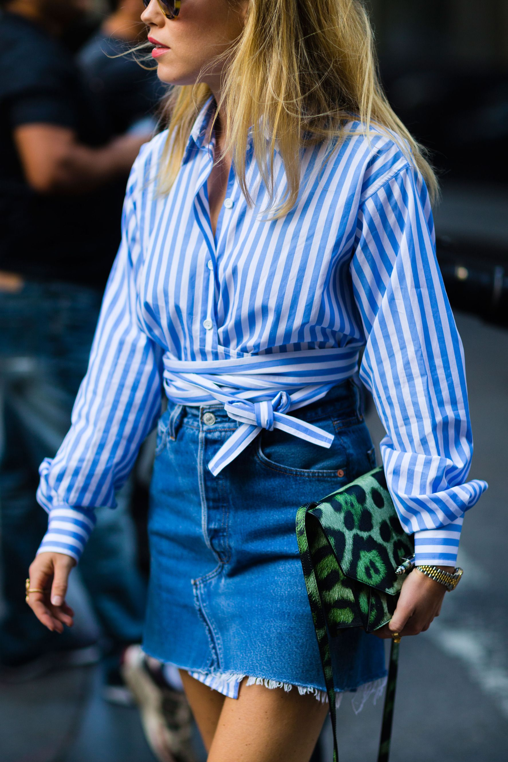 Striped wrap shirt is worn with a ripped denim skirt