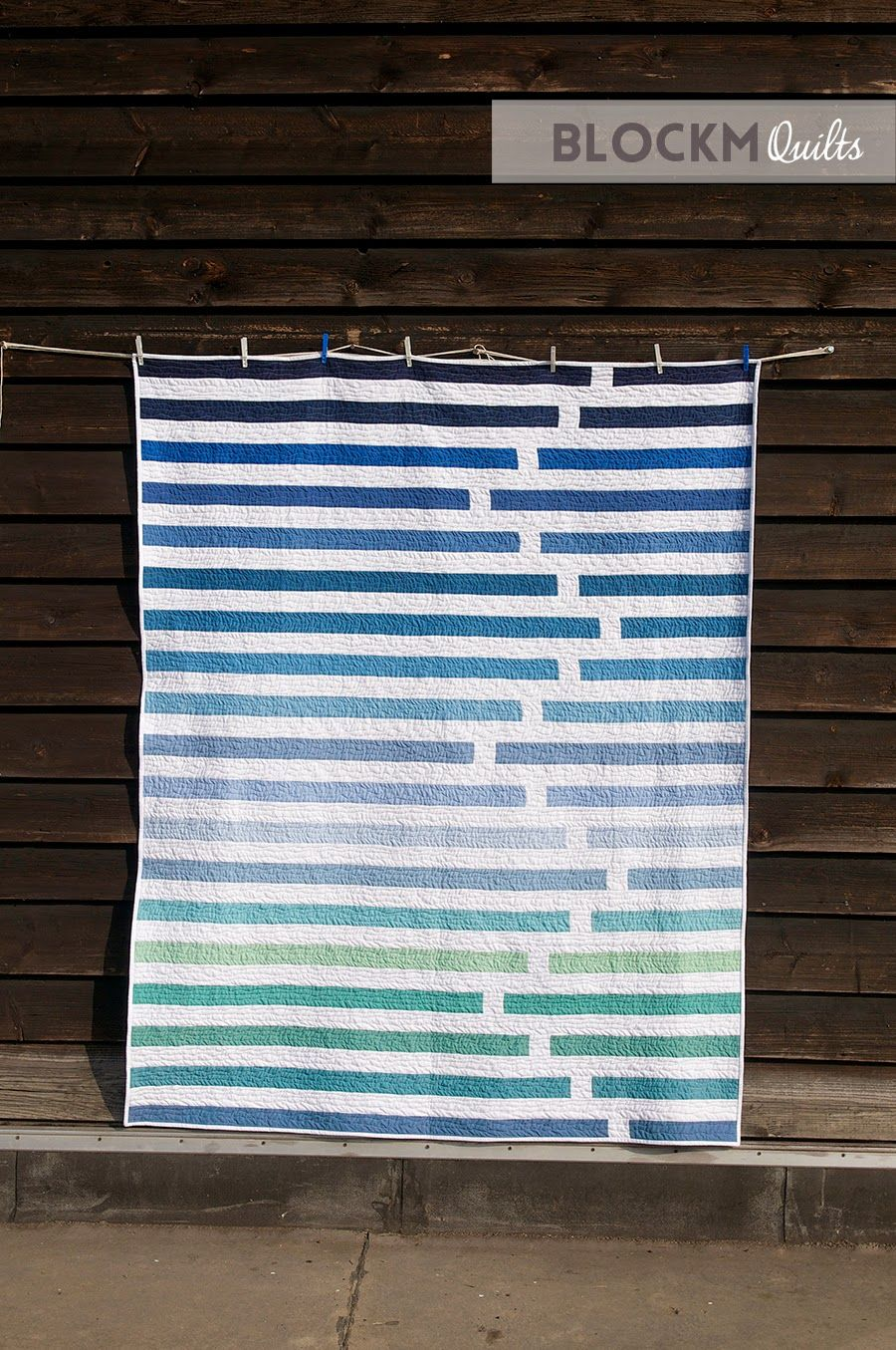 """Fun """"Regatta"""" quilt by Daniela O'Connell of Block M Quilts. Modern strip quilt, perfect for Jelly Rolls"""