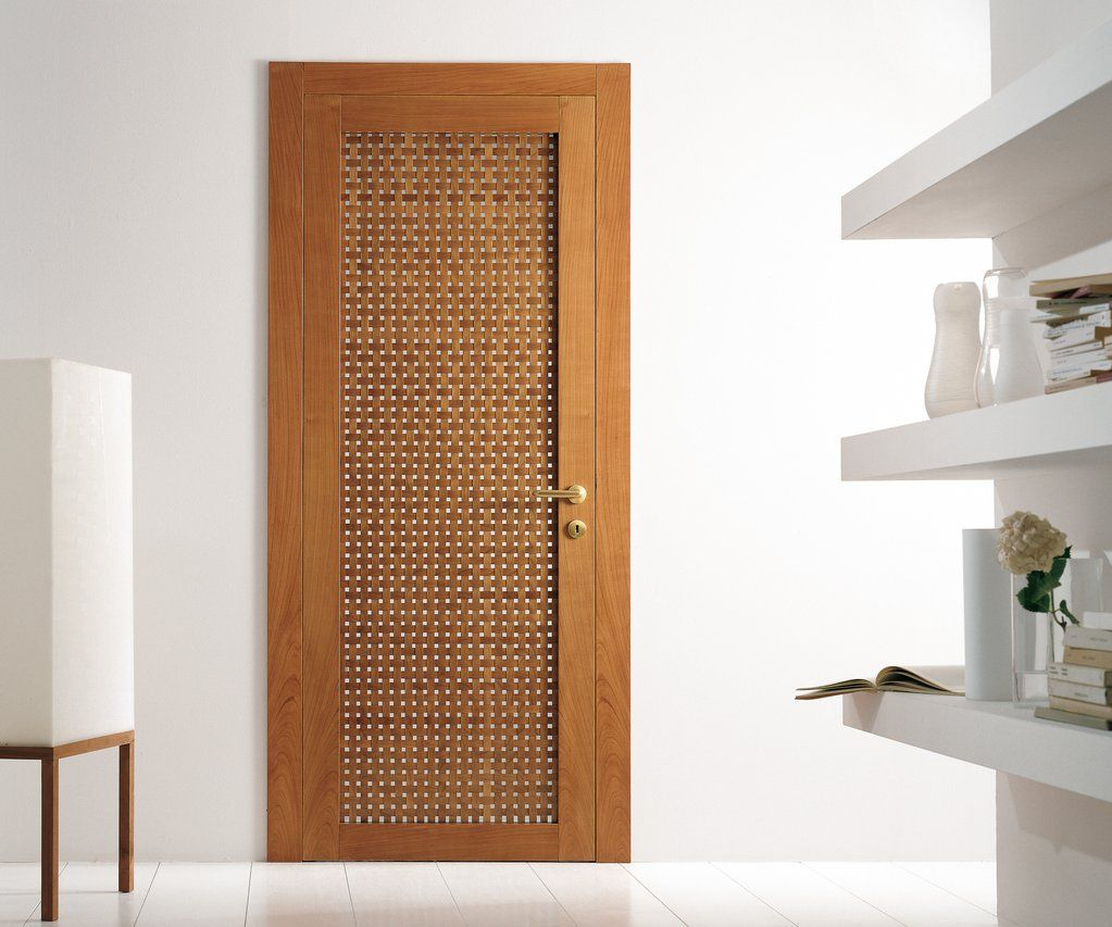 Modern interior swing door featuring a cherry wood lattice for Wooden door ideas