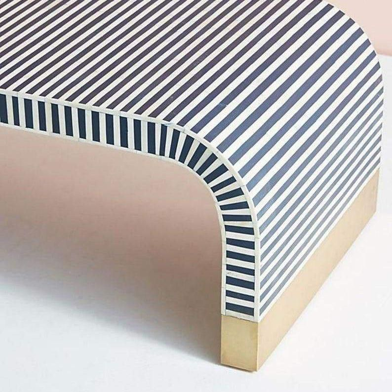 Beautiful minimalist with a twist coffee table. Makes a great accent in an otherwise modern space. Dimensions: 46
