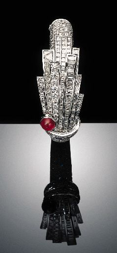 DIAMOND AND RUBY BANGLE BRACELET, BY HARRY WINSTON  The hinged pavé-set diamond bangle centering upon baguette, square, circular and triangular-cut diamond skyscrapers, enhanced by a cabochon ruby, mounted in platinum, diameter 23/8 ins., in a Harry Winston blue leather case  Signed HW for Harry Winston  Signed Disney  The total weight of the diamonds is approximately 30.00 carats