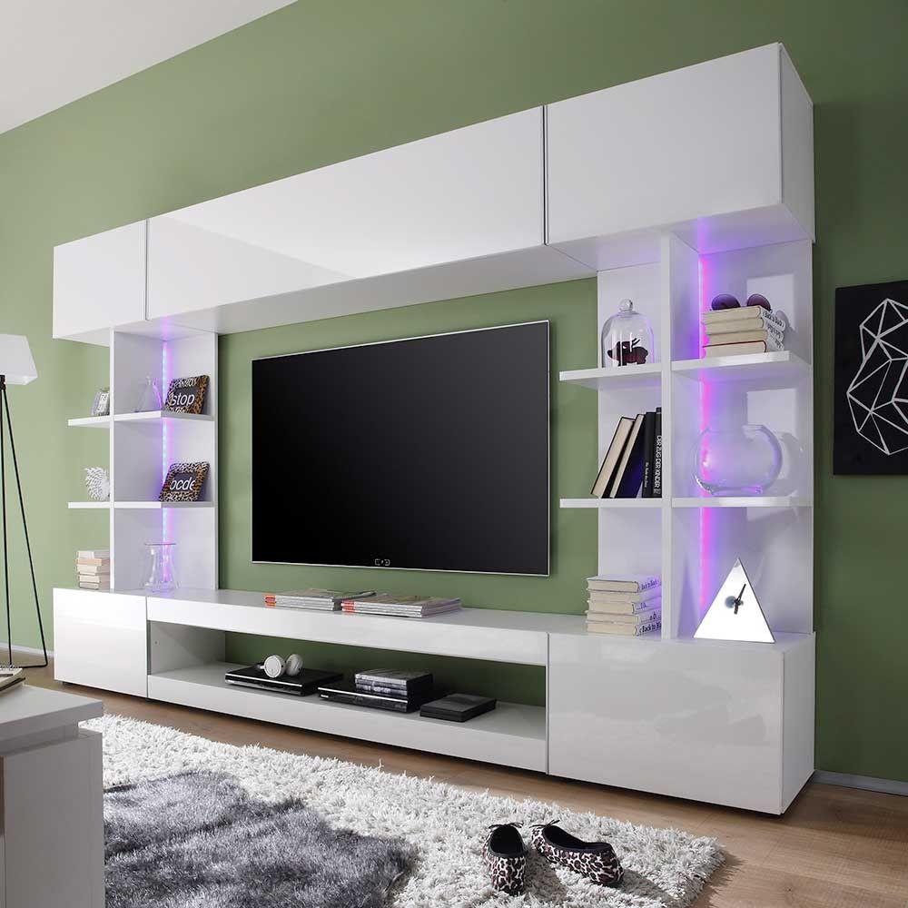 Die design schrankwand in weiß hochglanz ist ein tolles highlight für ihre moderne wohnungseinrichtung ein echtes stauraumwunder