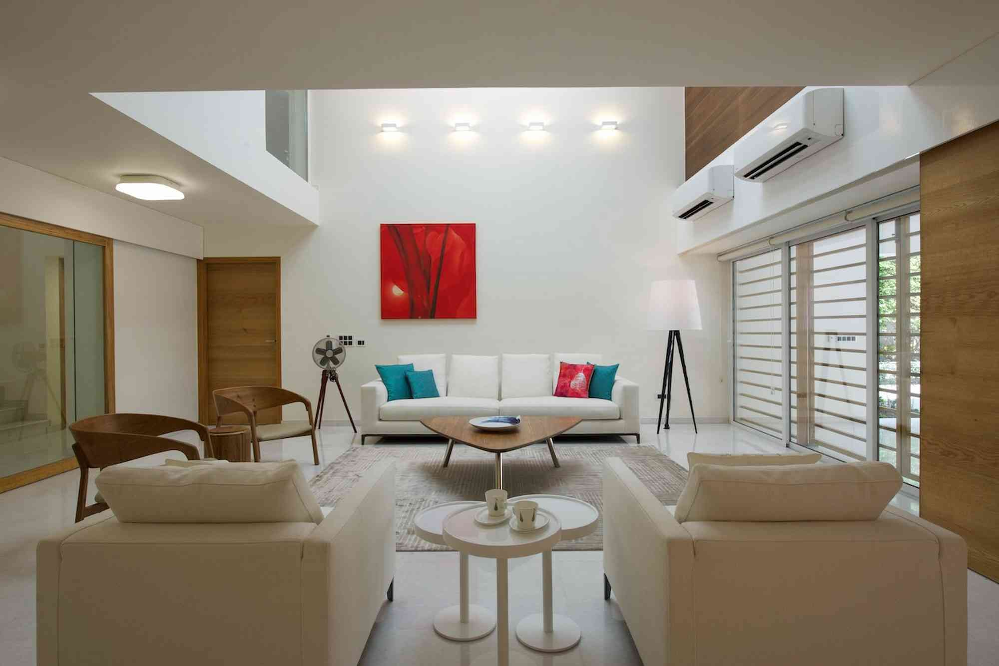 Home interior design kerala living room in white with splashes of red and turquoise  ashish