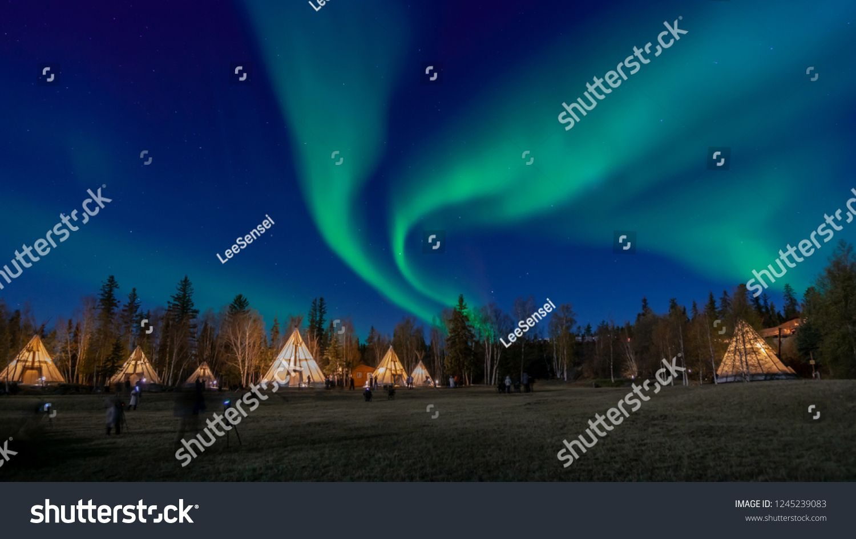 Many lightup Tipi with Aurora Borealis at Yellow Knife