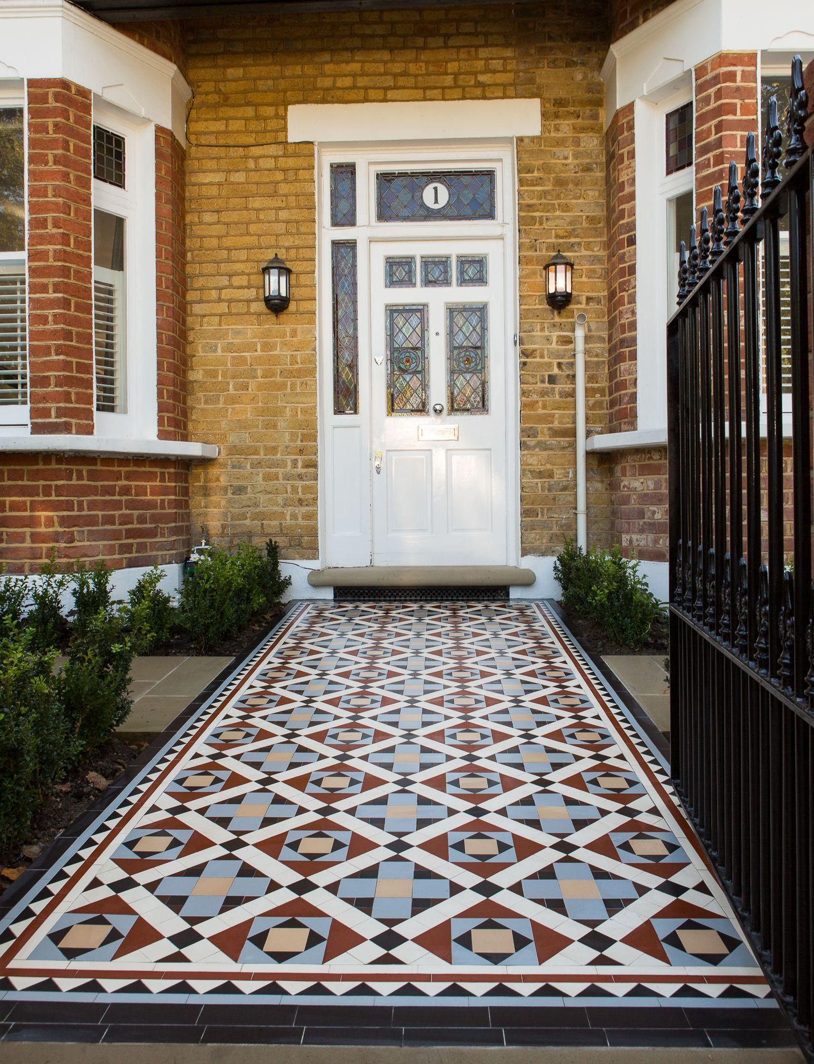 Modern garden house  Edwardian style hand laid mosaic pathway in stylish modern London