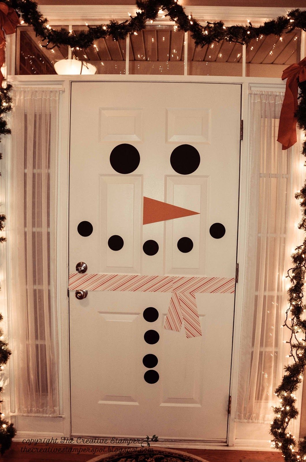 Take advantage of your all-white door by turning it into a paper snowman with simple paper cut-outs. Get the tutorial at The Creative St&er Spot & 30 Festive Christmas Door Decorations | Snowman Tutorials and Creative