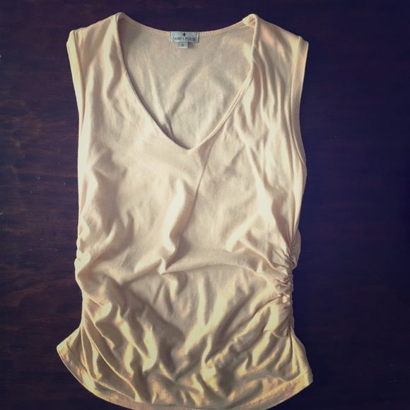 James Perse Knit Tank Size 2 James Perse Knit Tank Size 2.  Beige/peach color.  Scrunched sides that make this top very fitted and sexy.  Gently used and in excellent condition.  Smoke free home. James Perse Tops Tank Tops