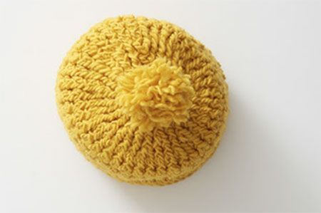 This squishy, textured hat features double sided three-dimensional ridges and pebbles. The hat can be worn either side out.