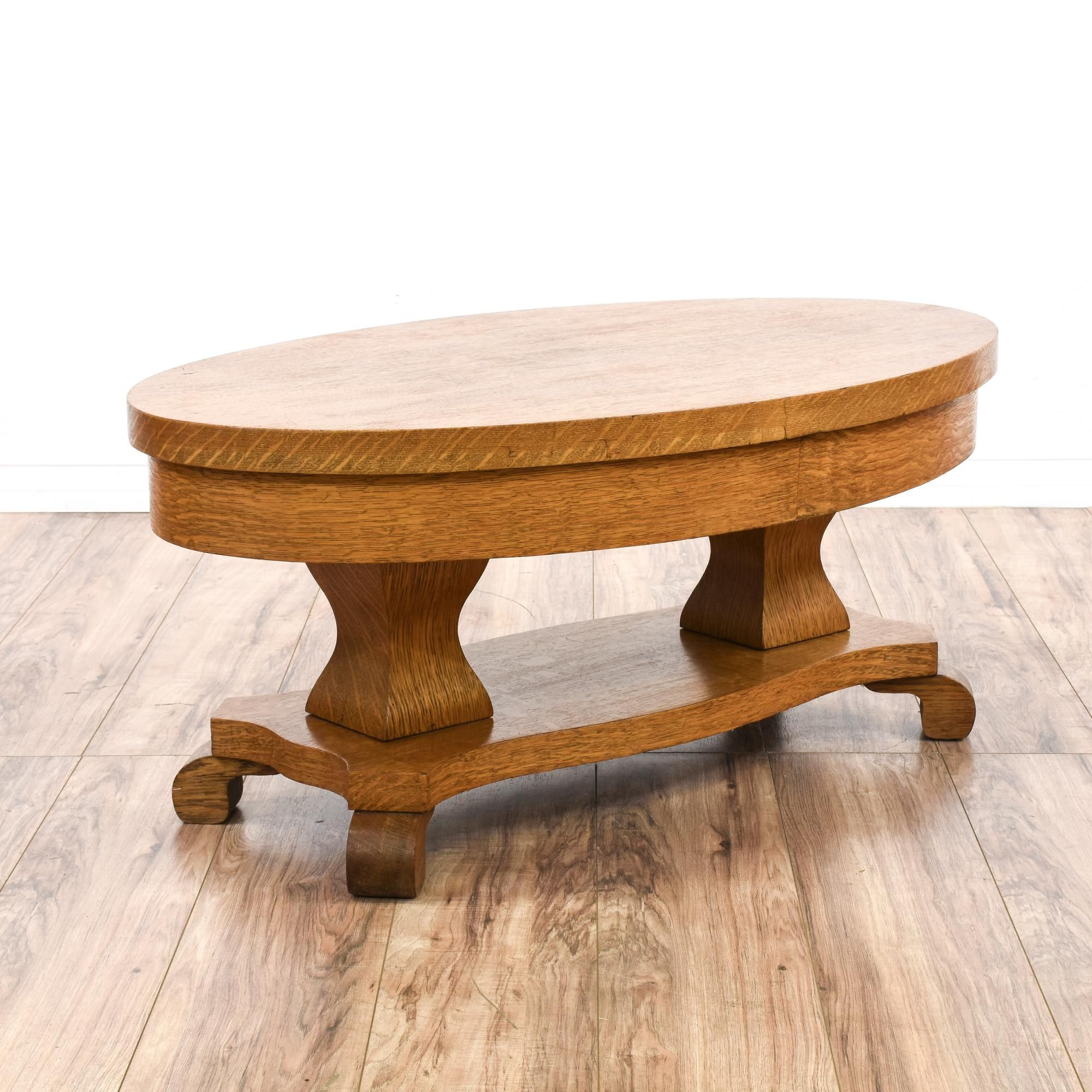 This empire style coffee table is featured in a solid wood with a