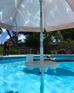 Aughog Relaxation Station Swimming Pool Table With Umbrella Pool Shade Backyard Pool Landscaping Pool Lounge