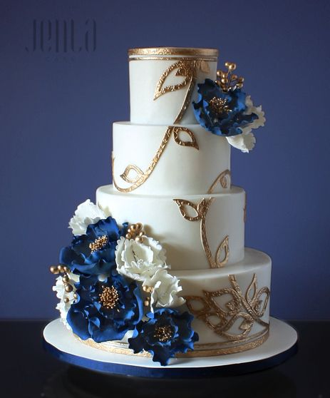 Royal Blue And Gold Wedding Decorations: This Wedding Cake Features Intricate Gold Filigree