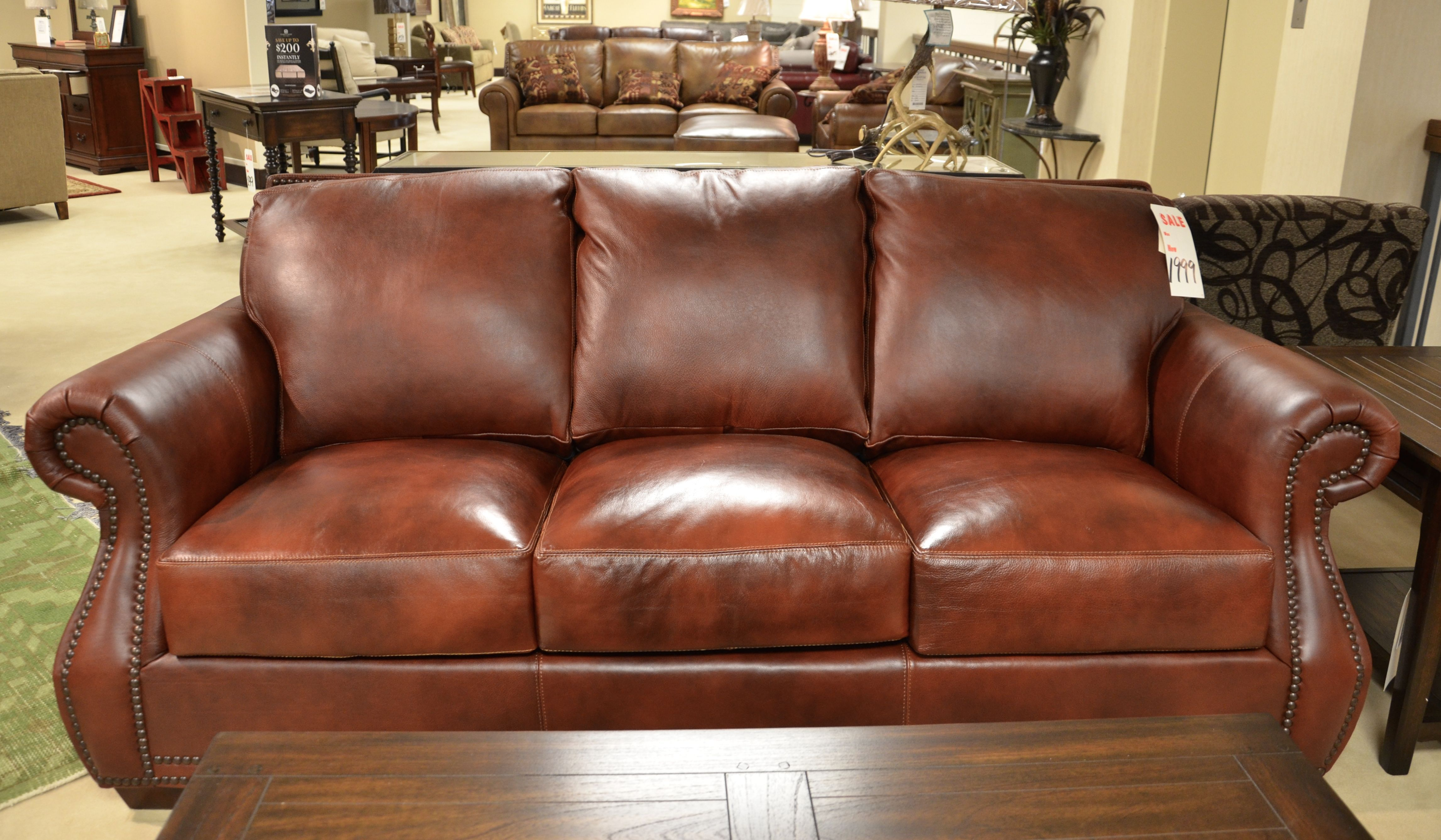 lane home furnishings leather sofa and loveseat from the bowden collection gray tufted chesterfield with nail head studded trim casual furniture