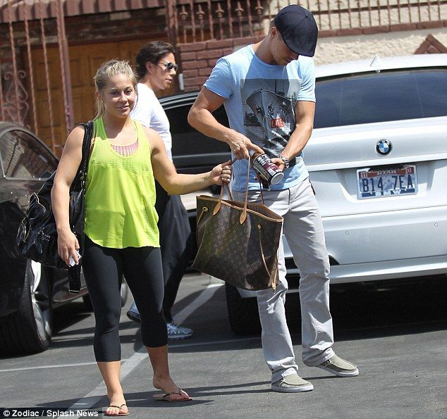 Pamela Anderson emerges from DWTS rehearsals in what seems to be a cardigan