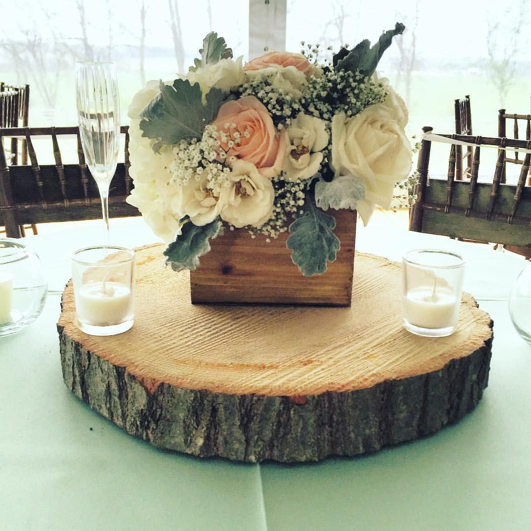 A rustic romantic wooden planter box centerpiece created