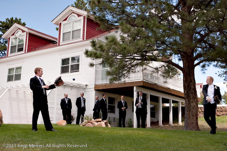 The groom and groomsmen play catch before the wedding.